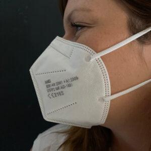 Woman wearing FFP2 face mask
